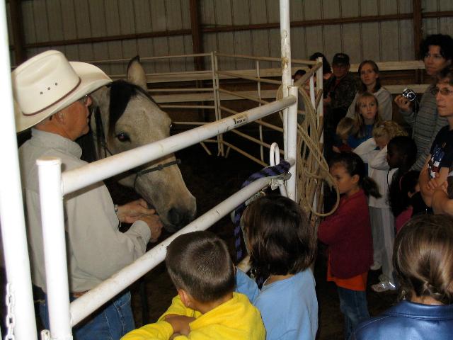 Marvin with school kids, Willis Creek Ranch
